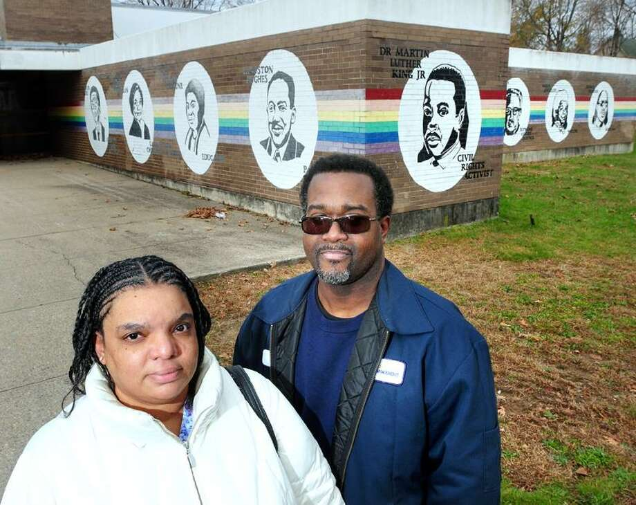 Sandra Maynard and her husband Michael stand in front of the former Martin Luther King School on Dixwell Avenue in New Haven. The couple would like to see the vacant site be used for a new high school in Newhallville. Arnold Gold/New Haven Register
