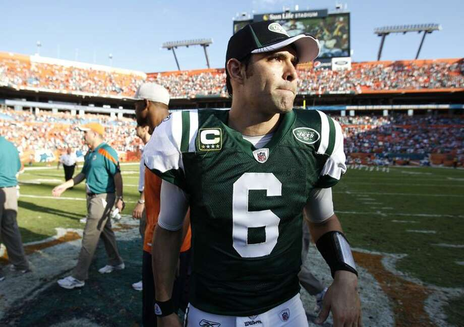 New York Jets quarterback Mark Sanchez (6) walks off the field following an NFL football game against the Miami Dolphins, Sunday, Jan. 1, 2012, in Miami. The Dolphins defeated the Jets 19-17. (AP Photo/Lynne Sladky) Photo: AP / AP2012