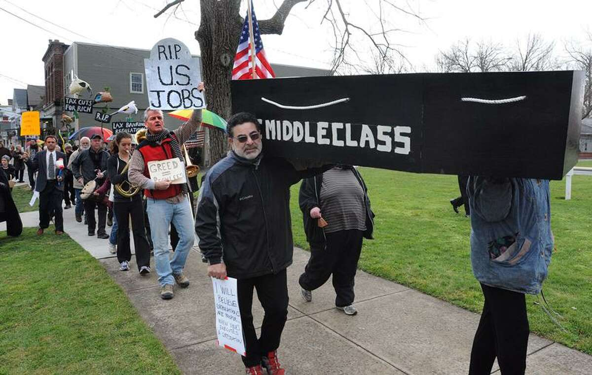 Occupy Shoreline protesters, including Aziz Dehkan, front, held a funeral march for the middle class around the Guilford Green. Peter Casolino/Register