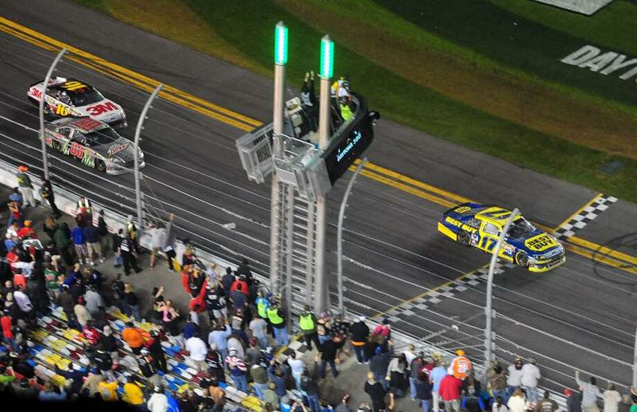 Feb. 27, 2012; Daytona Beach, FL, USA; NASCAR Sprint Cup Series driver Matt Kenseth takes the checkered flag to win the Daytona 500 at Daytona International Speedway. The race is being run on Monday for the first time in the 54 year history of the race due to rain. Mandatory Credit: Mark J. Rebilas-US PRESSWIRE Photo: US PRESSWIRE / Mark J. Rebilas