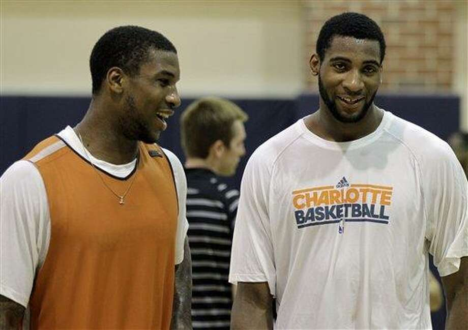 Thomas Robinson, left, talks with Andre Drummond, right, after working out for the Charlotte Bobcats in an NBA basketball practice in Charlotte, N.C., Friday, June 22, 2012. Robinson and Drummond are both possible NBA Draft picks on June 28.  (AP Photo/Chuck Burton) Photo: ASSOCIATED PRESS / AP2012