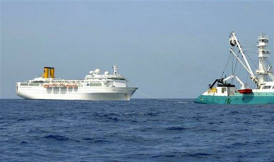 In this photo taken by a member of French fishing vessel, The Talenduic, and provided by the Prefecture of the Reunion Island, shows the Italian cruise ship, The Costa Allegra, left, being towed by French fishing vessel, The Trevignon, in the Indian Ocean, Tuesday. Associated Press Photo: AP / Reunion Island Prefecture