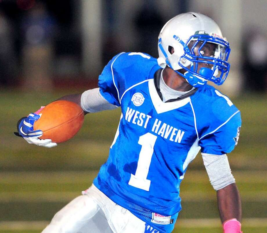 Ervin Philips of West Haven runs against Cheshire in the first half of a regular-season game. Phillips hopes to lead the Westies to a Class LL state playoff berth by beating Fairfield Prep on Thanksgiving Day. Photo by Arnold Gold/New Haven Register