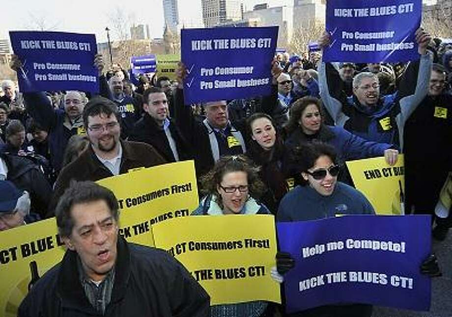 People rally outside the Capitol in support of retail alcohol sales on Sundays in Hartford, Conn., Tuesday, Feb. 28, 2012. The lobbyist for the Connecticut Package Stores Association says his group is now supporting retail sales of alcohol on Sundays. But many liquor store owners have opposed efforts for years, saying it would cost too much money in staffing. (AP Photo/Jessica Hill) Photo: AP / AP2012
