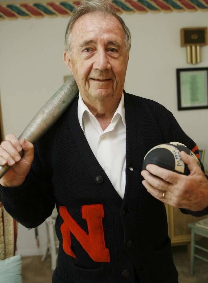 Dispatch Staff Photo by JOHN HAEGER Pat McCarthy, a football and baseball standout at Nottingham High School, still fits into his school sweater. The 85-year-old will be inducted into the Nottingham Wall of Fame in October.