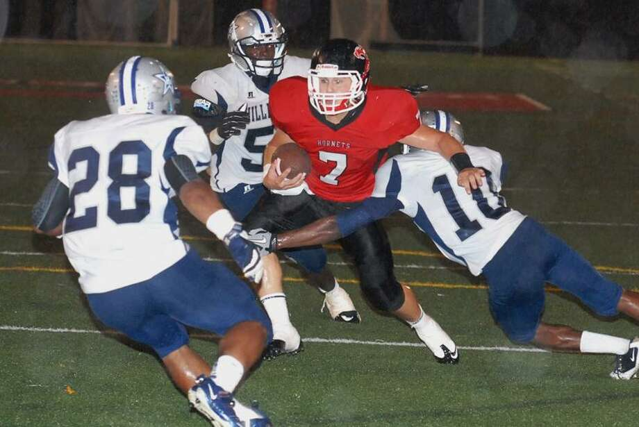 Branford's Justin Bloood looks for yardage during a recent game against Hillhouse. Bill O'Brien/For the Register.