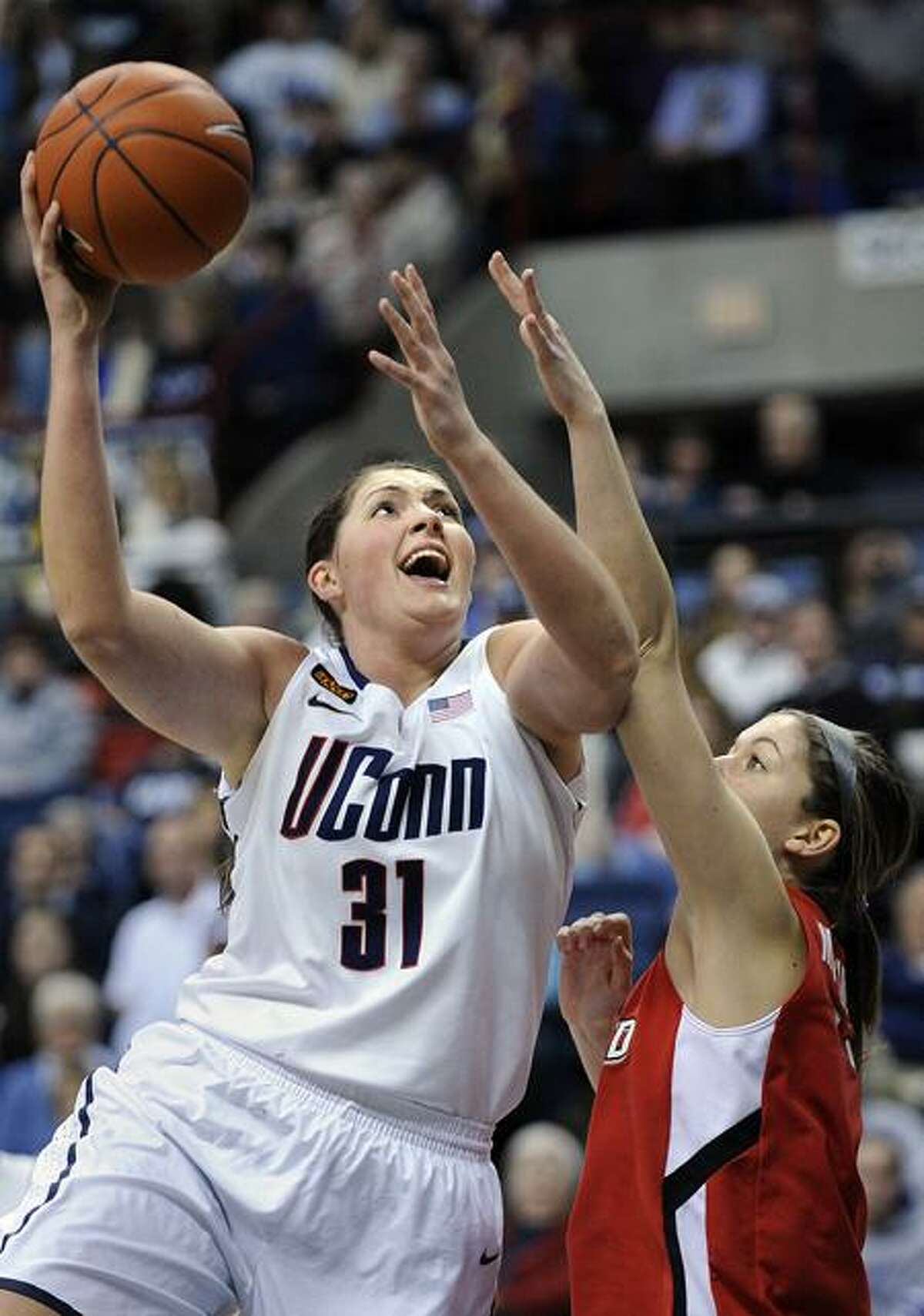 Connecticut's Stefanie Dolson, left, shoots over Fairfield's Brittany MacFarlane during the first half of an NCAA college basketball game, Thursday, Dec. 29, 2011, in Storrs, Conn. (AP Photo/Fred Beckham)