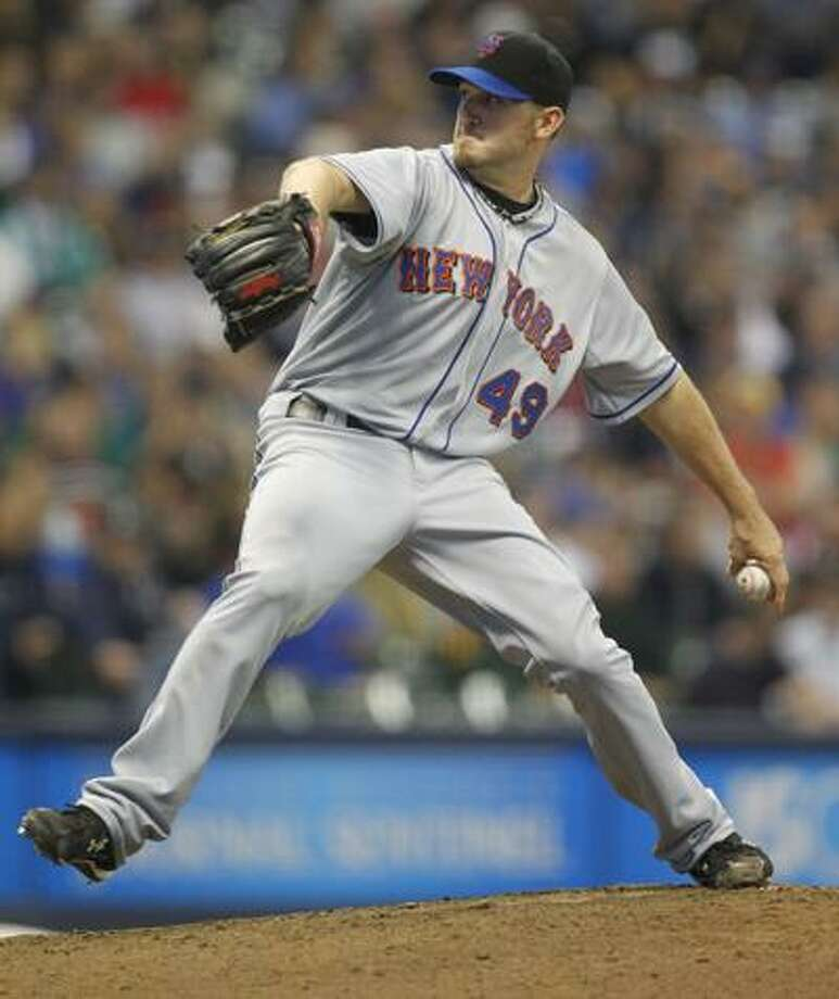 New York Mets starting pitcher Jonathon Niese throws against the Milwaukee Brewers in the fifth inning of a baseball game on Thursday, June 9, 2011, in Milwaukee.  (AP Photo/Jeffrey Phelps) Photo: AP / FR59249 AP