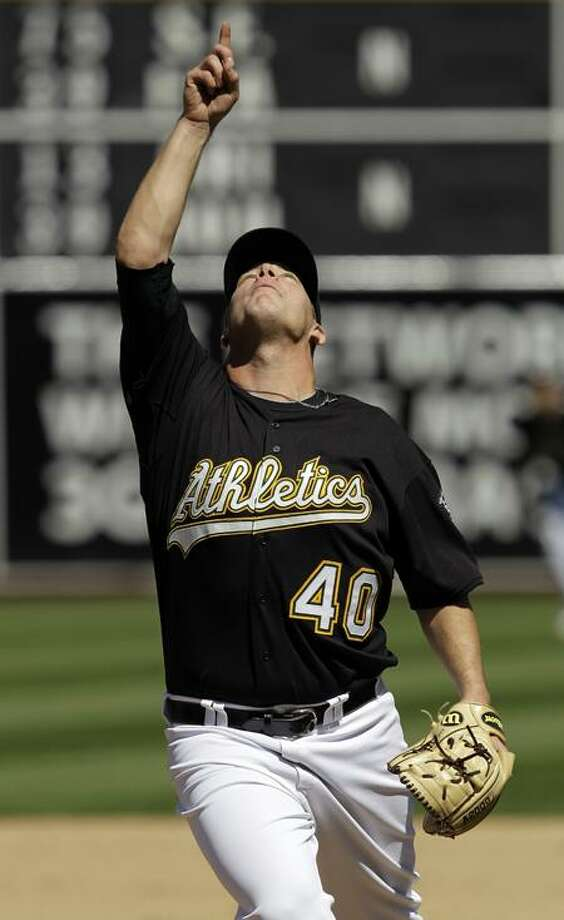 Oakland Athletics relief pitcher Andrew Bailey points skyward as he records the last out of the game against the Texas Rangers in a baseball game in Oakland, Calif., Wednesday, May 5, 2010. Oakland won 4-1. (AP Photo/Marcio Jose Sanchez) Photo: AP / AP2010
