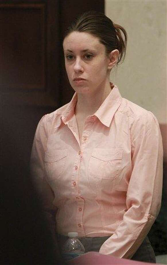 Casey Anthony stands for the entrance of the jury during her murder trial at the Orange County Courthouse, Wednesday, June 8, 2011 in Orlando, Fla. Anthony, 25, is charged with killing her daughter Caylee in the summer of 2008. (AP Photo/Joe Burbank, Pool) Photo: AP / AP2011