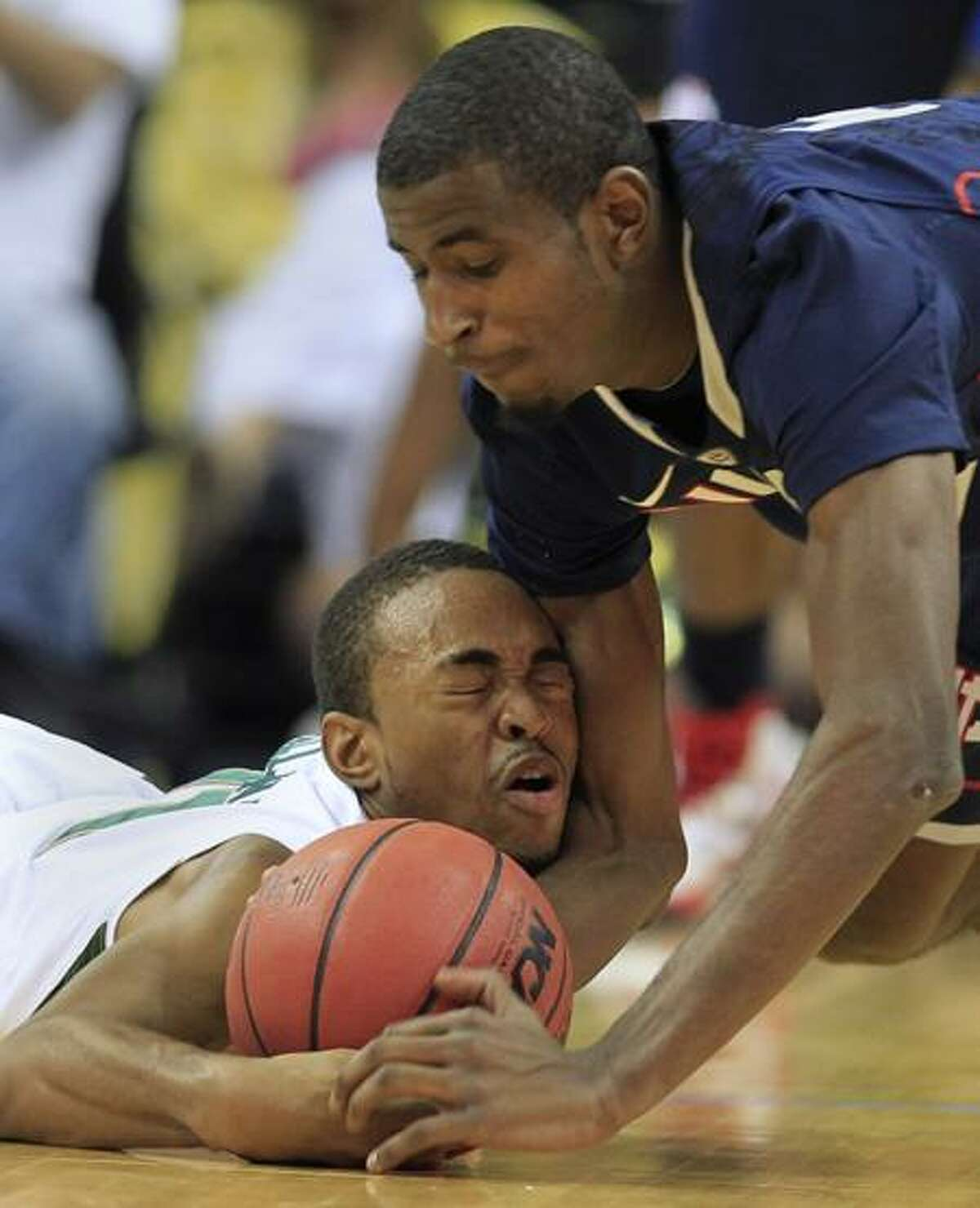 South Florida guard Anthony Collins, left, reacts as he runs into Connecticut forward DeAndre Daniels chasing a loose ball during the first half of an NCAA college basketball game Wednesday Dec. 28, 2011, in Tampa, Fla. (AP Photo/Chris O'Meara)