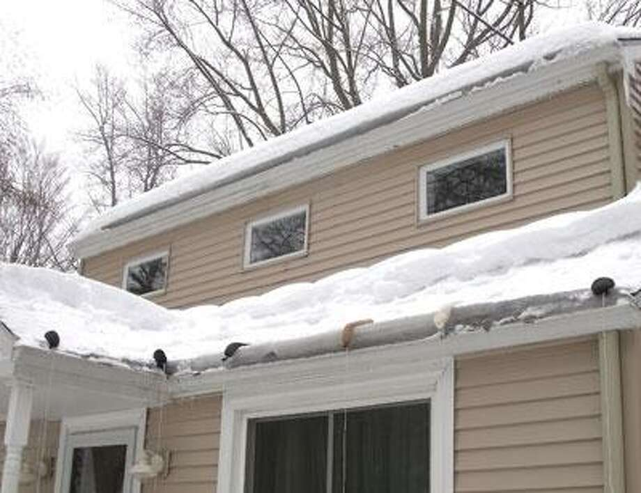 Allison Brancato of Guilford shared a photo with the New Haven Register of a wallet-friendly, do-it-yourself solution she uses to melt ice on her roof.  Brancato fills old stockings with ice melt and places them along the path of her gutters. They resemble a water-filled balloon once they're stuffed. Within a couple of hours, the ice is melting and a channel forms for the water to flow through.