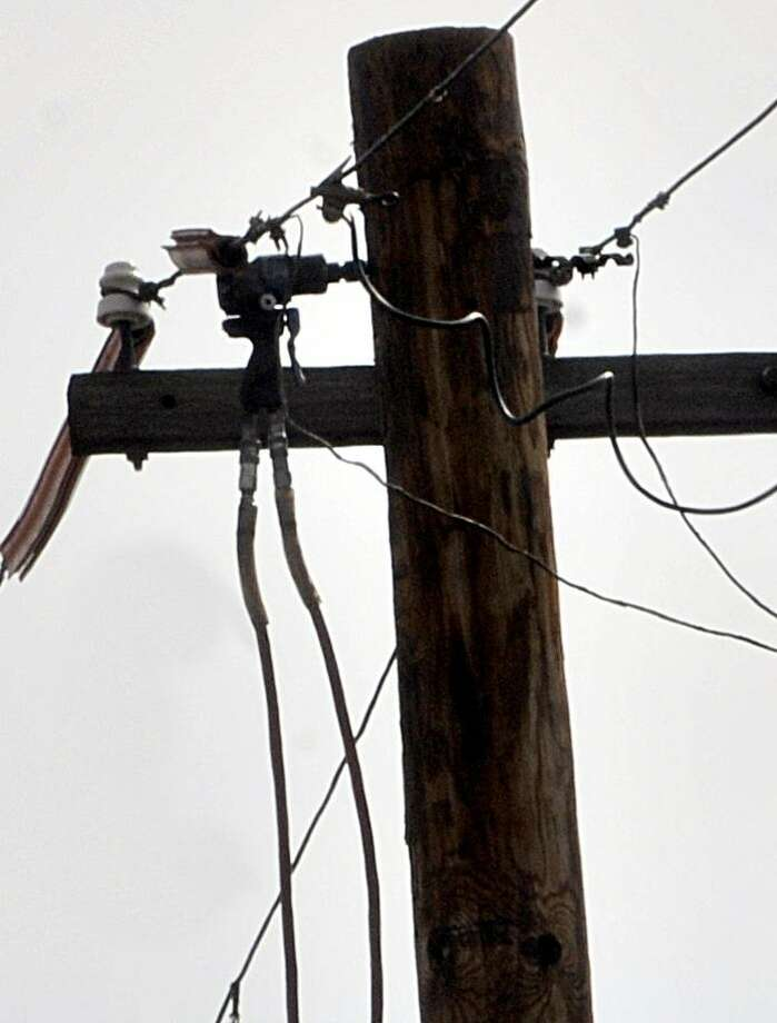 WEST HAVEN- An UI worker was flash burned when he drilled into a wire on Campbell  Ave, in West Haven. The drill remained embedded in the utility pole.   Melanie Stengel/Register   2/17/11