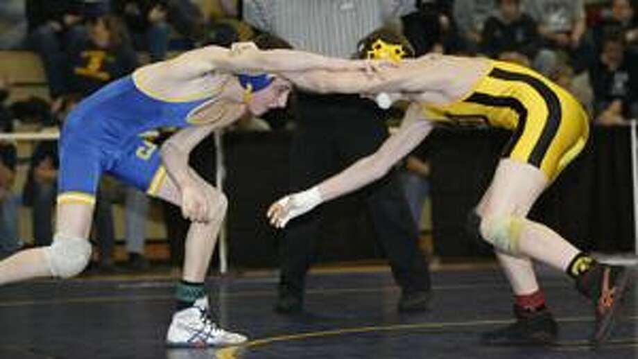 Photo by JOHN HAEGER Cazenovia's Nick Petroff, left, and South Jefferson's Jeron Tanner tie up in the finals of the 112 pounds Class B match in Oneida on Saturday, Feb. 5, 2011.