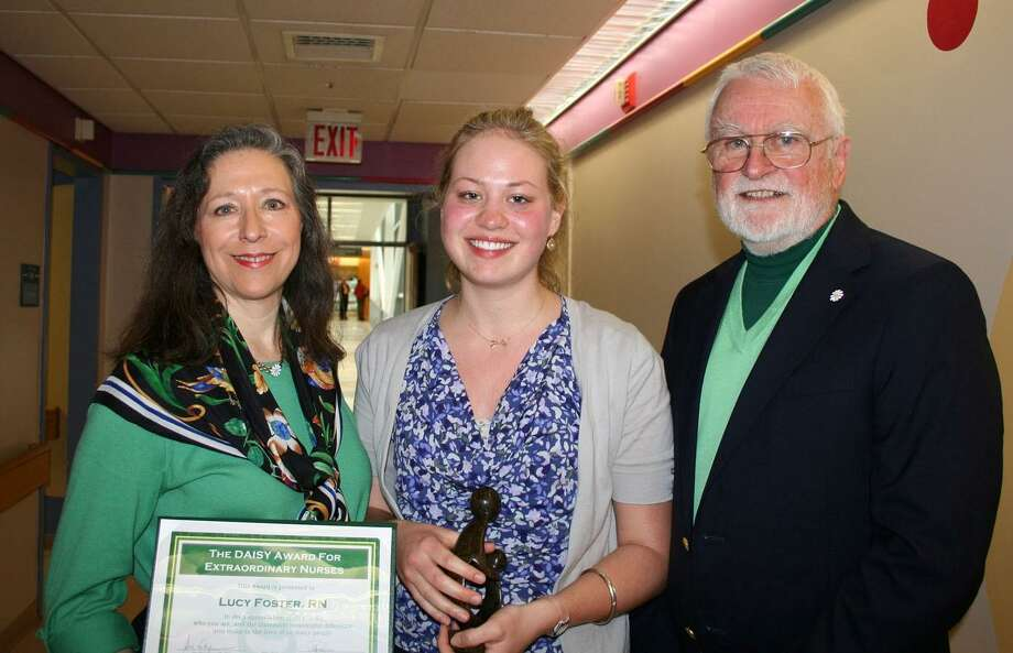 Nurse Lucy Foster, center, winner of the first DAISY Award at Yale-New Haven Hospital, is flanked by Bonnie and Mark Barnes, co-founders of the DAISY Award Foundation.  Contributed photo