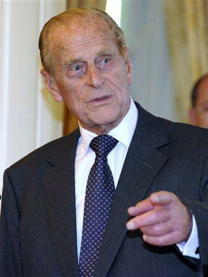 "File - Britain's Prince Philip arrives at Government House in Canberra, Australia,  in this Friday, Oct. 21, 2011 file photo.   Queen Elizabeth II's husband has been taken to the hospital after experiencing chest pains, British royal officials said Friday Dec 23, 2011. A spokeswoman for Buckingham Palace said Prince Philip was taken from Sandringham, the queen's sprawling estate in rural Norfolk, to the cardiac unit at Papworth Hospital in Cambridge for ""precautionary tests.""  (AP Photo / Torsten Blackwood, Pool, file) Photo: AP / AP POOL"