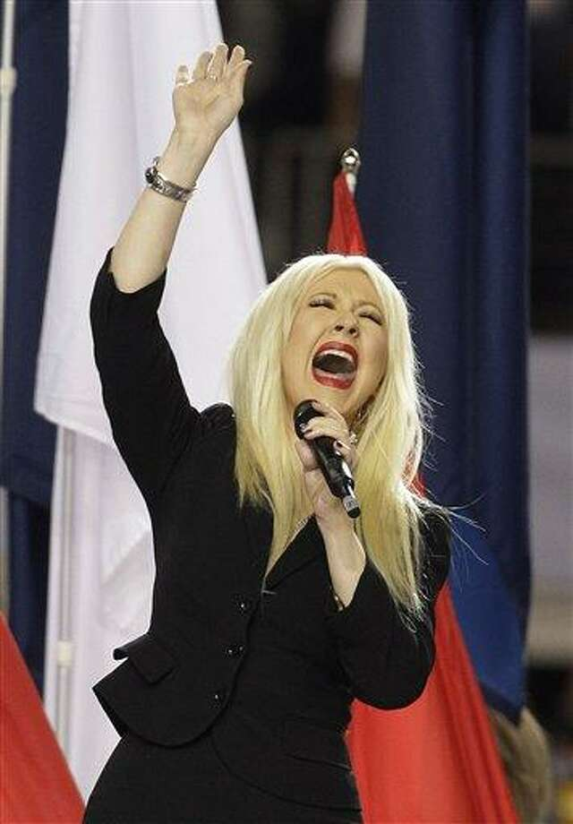 Christina Aguilera sings the national anthem before the NFL football Super Bowl XLV game between withe Green Bay Packers  and the Pittsburgh Steelers Sunday, Feb. 6, 2011, in Arlington, Texas. (AP Photo/Charlie Krupa) Photo: ASSOCIATED PRESS / AP2011
