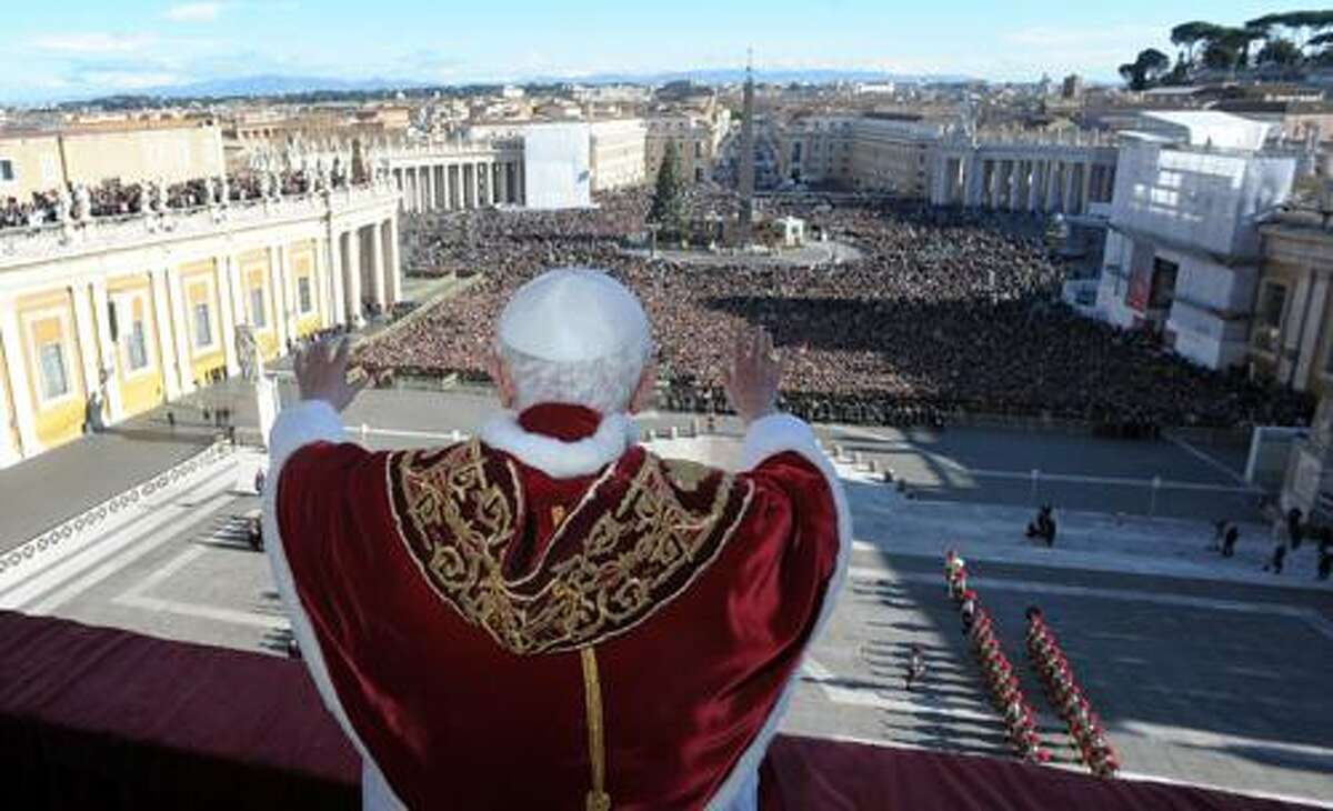 """In this photo provided by the Vatican paper L'Osservatore Romano, Pope Benedict XVI delivers his """"Urbi et Orbi"""" (to the City and to the World) speech from the central loggia of St. Peter's Basilica, at the Vatican, Sunday, Dec. 25, 2011. Benedict XVI called for an end to the bloodshed in Syria and the resumption of Israeli-Palestinian peace talks in his Christmas message Sunday, an appeal for peace that was challenged by deadly attacks on two Nigerian churches. (AP Photo/L'Osservatore Romano)"""