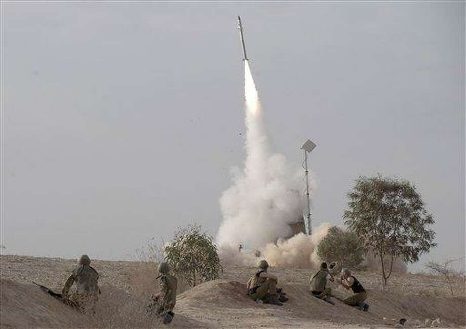 An Israeli Iron Dome missile is launched near the city of Be'er Sheva, southern Israel, to intercept a rocket fired from Gaza Saturday, Nov. 17, 2012. Israel bombarded the Hamas-ruled Gaza Strip with nearly 200 airstrikes early Saturday, the military said, widening a blistering assault on Gaza rocket operations to include the prime minister's headquarters, a police compound and a vast network of smuggling tunnels. (AP Photo/Ahikam Seri) Photo: AP / AP