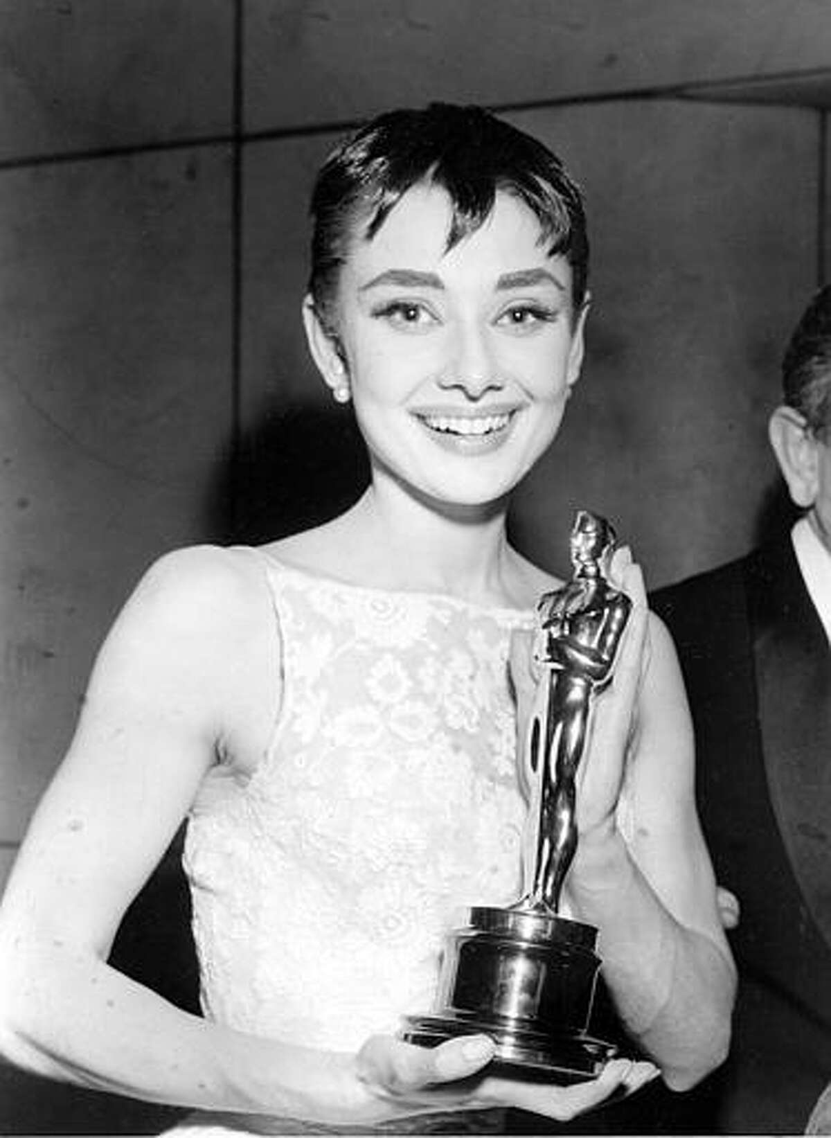 """Actress Audrey Hepburn poses with her Oscar statuette at the annual Academy Awards presentations in New York, on March 24, 1954. Hepburn was awarded best actress for her only first movie starring role, the portrayal of a free-spirited Princess in the motion picture """"Roman Holiday."""" Associated Press"""