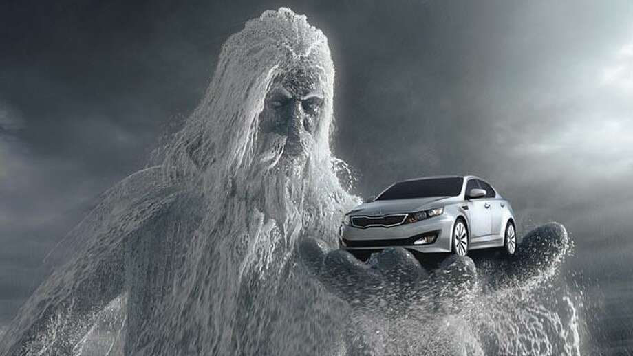 """This screen shot provided by Kia Motors Corp., shows a scene from the Super Bowl commercial titled """"One Epic Ride,"""" with the all-new 2011 Kia Optima being held by Poseidon. (AP Photo/Kia Motor Corp.) ** NO SALES ** Photo: AP / Kia Motor Corp."""