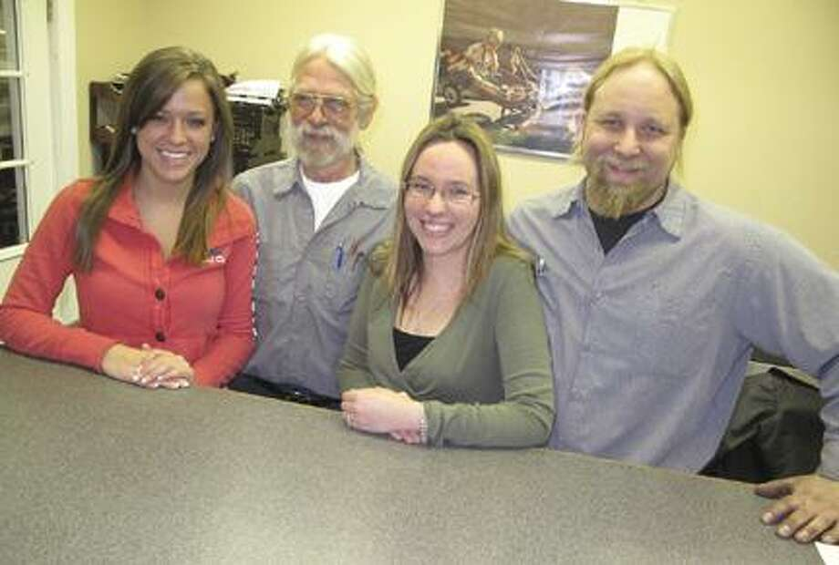 Dispatch Staff Photo by JOHN HAEGER The crew of the new Sherrill Auto Repair and Machine, including, from left, Abby DuBuke, Rob DuBuke, Karin Musgrove, and Jon Musgrove, pose at their Route 5 location.