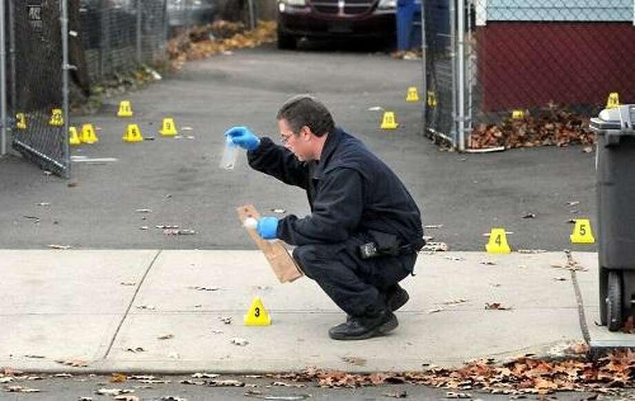 New Haven Det. Frank Melendez investigates a fatal shooting at 54 Dewitt St. Mara Lavitt/New Haven Register11/17/12