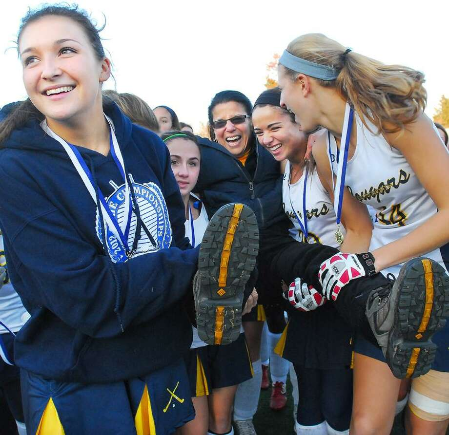 Haddam-Killingworth head coach Patsy Kamercia is carried off the field by players, from left to right, Jennifer Venuti, Marissa Moncata, Taylor Burger and Kiley Anderson following their 2-0 win over Stonington for the Class S state championship at Wethersfield High School Saturday afternoon. Catherine Avalone/The Middletown Press