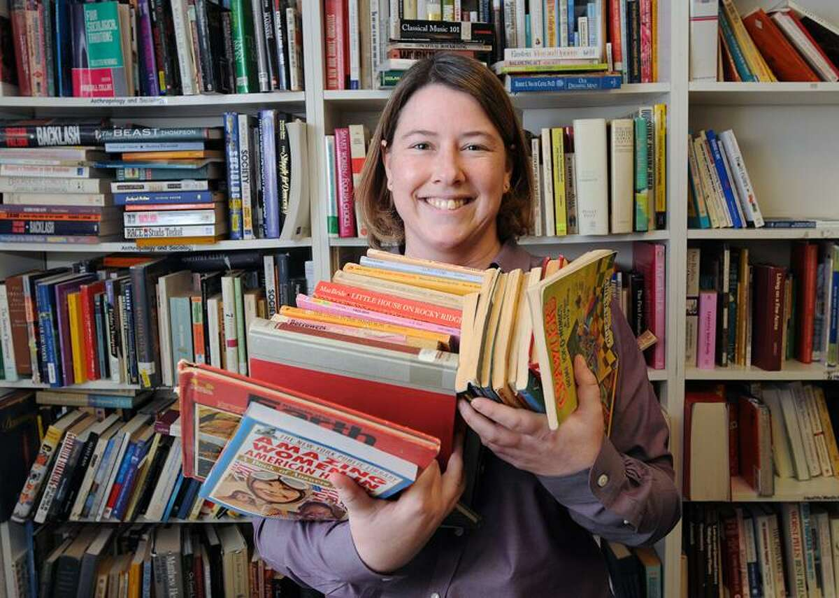Fiona Bradford, assistant director of New Haven Reads, helps provide children in New Haven with gently used books for free. Peter Casolino/New Haven Register