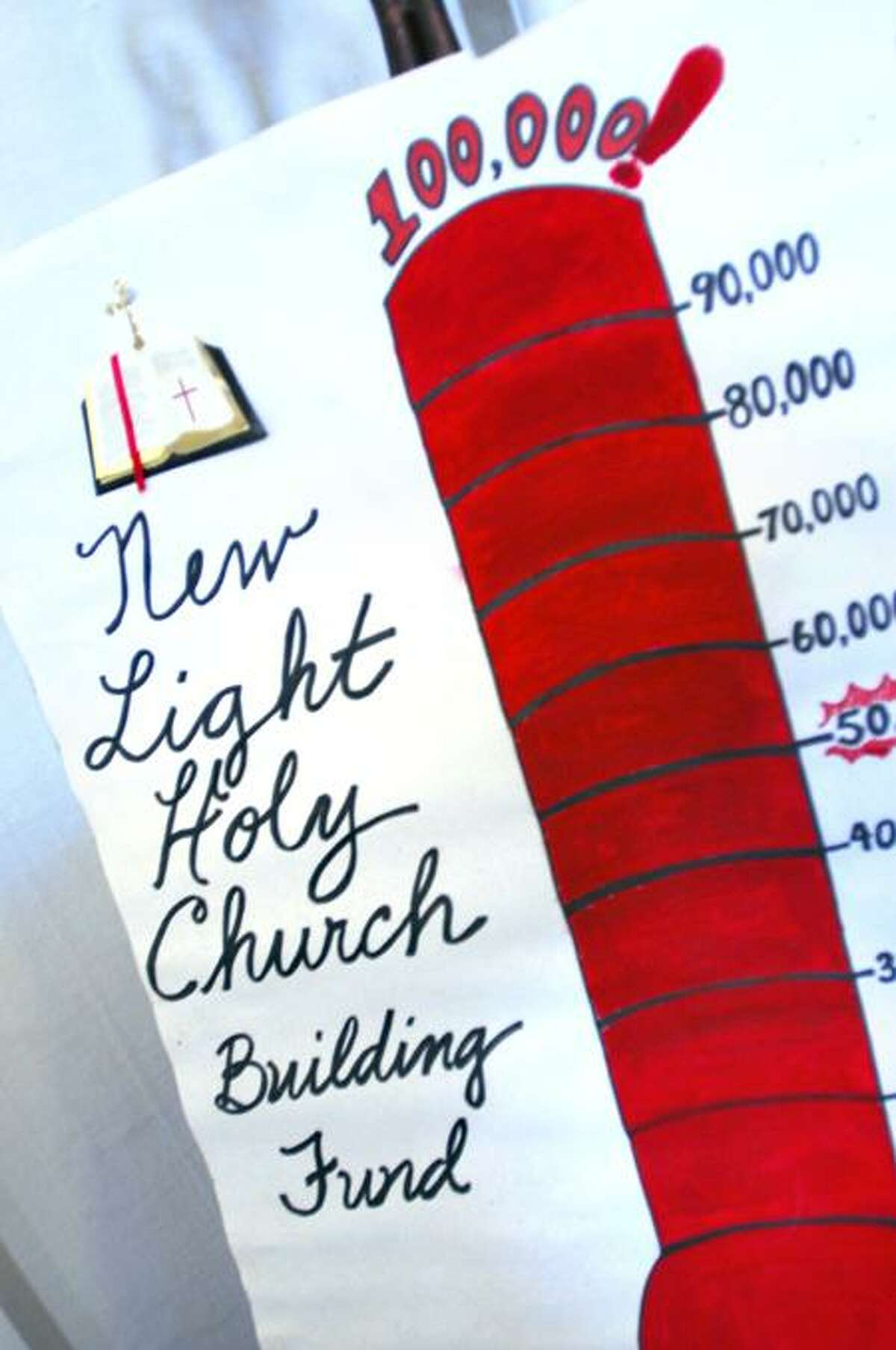 A building fund poster sits at the entrance to the New Light Holy Church on Howard Avenue in New Haven. Photo by Arnold Gold/New Haven Register
