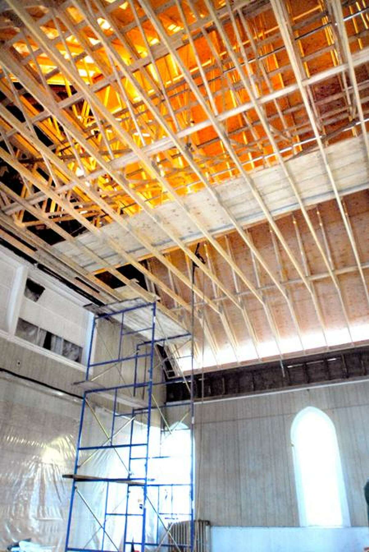 The roof under construction can be seen in the sanctuary at the New Light Holy Church on Howard Avenue in New Haven. Photo by Arnold Gold/New Haven Register