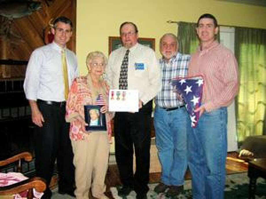 SUBMITTED PHOTO From left are Neal Capone, Rachel Capone, Madison County Veterans Service Agency Representative, Donald Smith, Harry Capone and Harry Capone Jr.