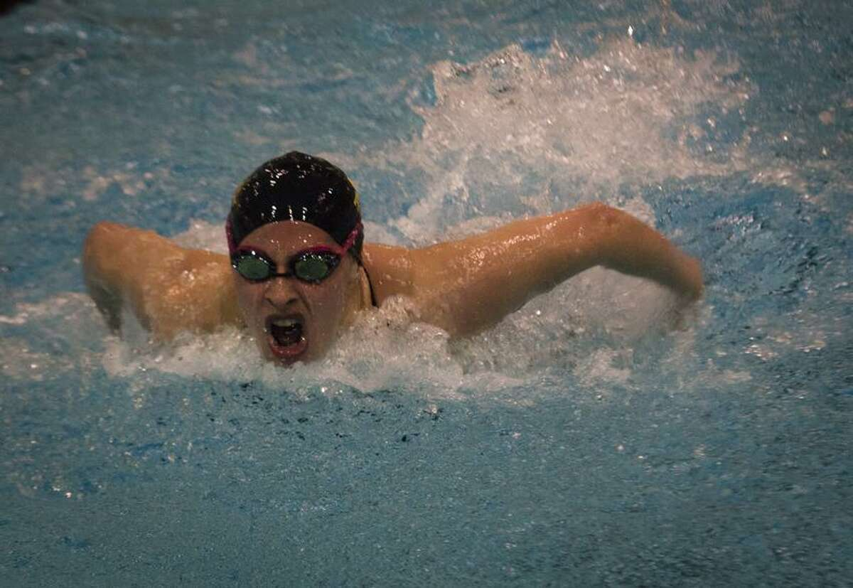 Amity's Dana Grindall won the 100-yard butterfly for the fourth straight year at the State Open Saturday. Melanie Stengel/Register