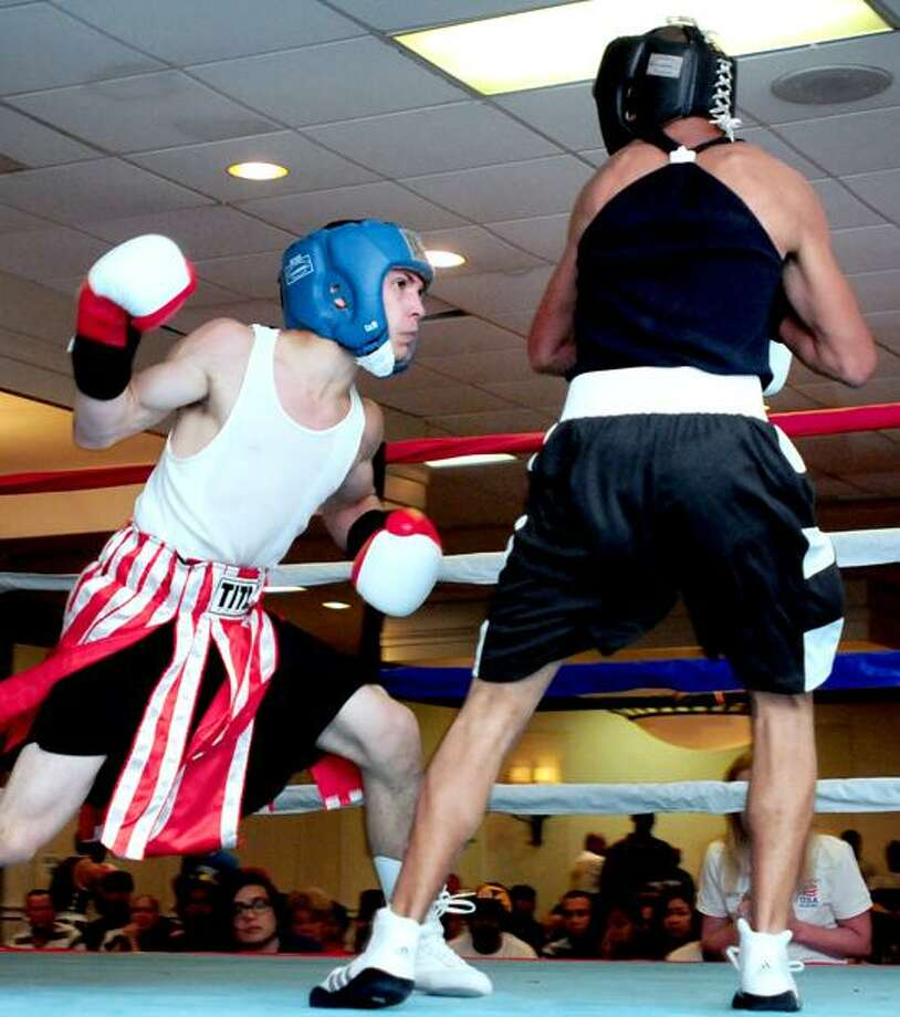 Luis Rosa (left) fights Eliza Peizoto in the Dave Solomon Fresh Air Fights in North Haven on 6/16/2012.Photo by Arnold Gold/New Haven Register      AG0453C