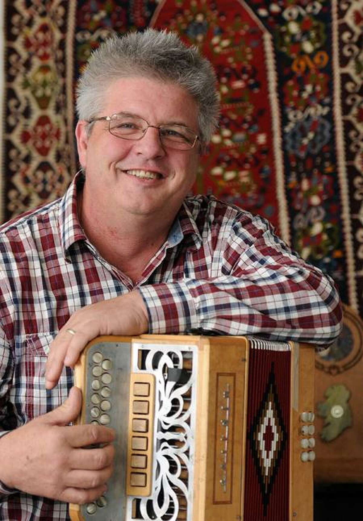 John Whelan, a world renowned button accordion player, in his Milford home. Peter Casolino/New Haven Register
