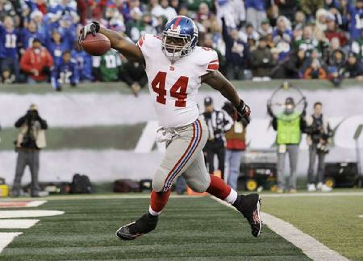 New York Giants' Ahmad Bradshaw steps in to the end zone to score a touchdown during the third quarter of an NFL football game against the New York Jets, Saturday, Dec. 24, 2011, in East Rutherford, N.J. (AP Photo/Julio Cortez)