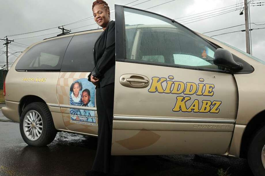 Tonya Chapman of New Haven, owner of Kiddie Kabz, a Hamden business that drives children to various destinations local and more far flung. Mara Lavitt/New Haven Register10/10/12
