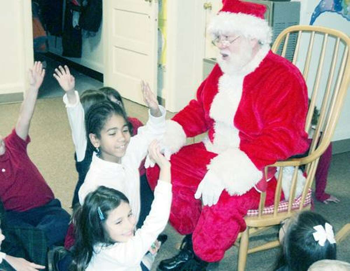 Photo Courtesy ST. PATRICK'S ELEMENTARY Santa is pictured answering the questions of second grade students.