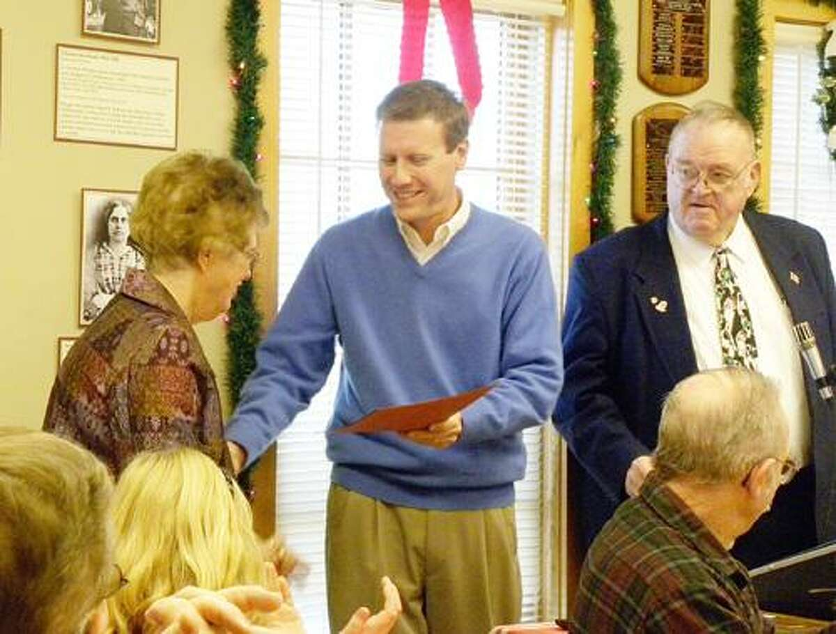 Photo Courtesy Chittenango Landing Canal Boat Museum Joan DiChristina receives her proclamation, presented by Sen. David Valesky, D-49, and Assemblyman William Magee, D-111.