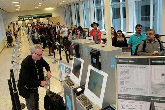 Passengers wait in a Transportation Security Administration line at Bush Intercontinental Airport. The agency screened a record number of passengers and crew in July at Bush and Hobby airports.