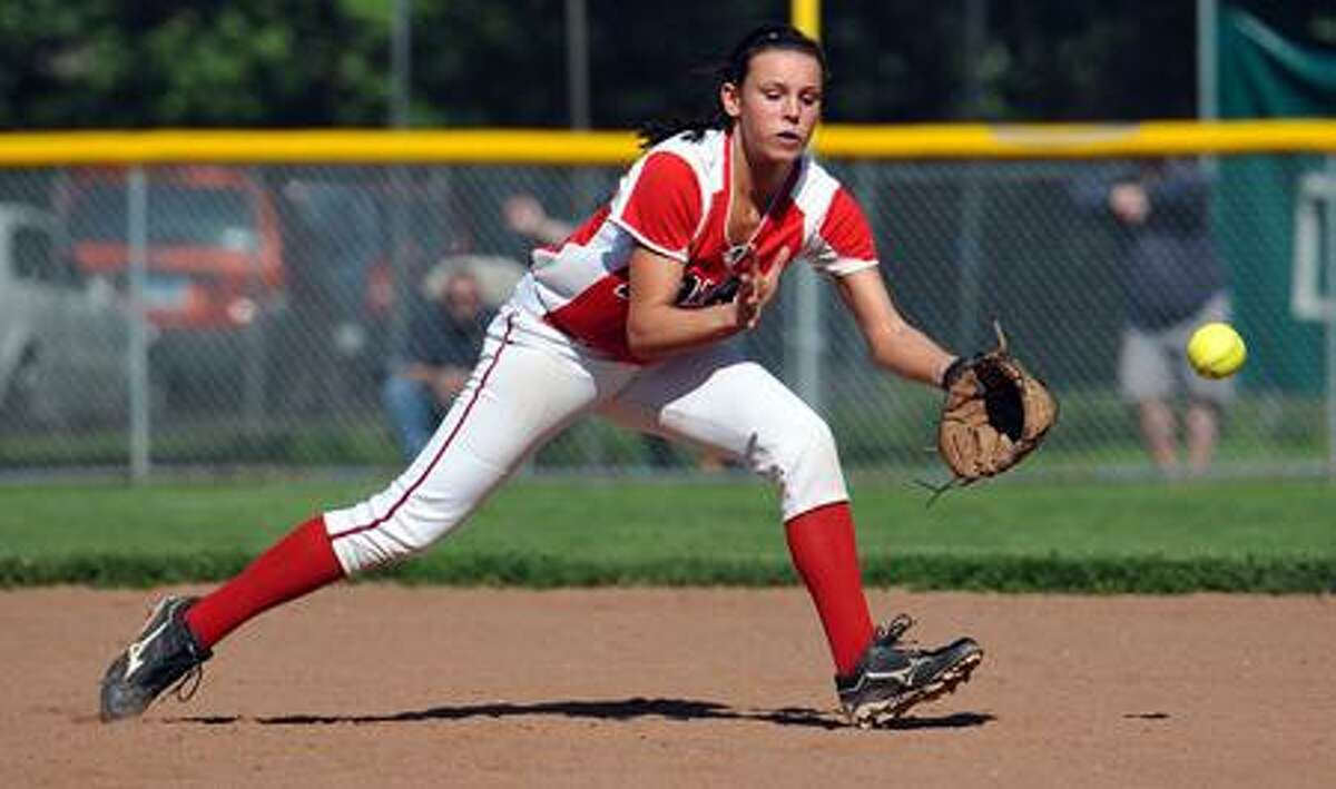 Foran's Brooke Phelan can't get a handle on a first inning line drive. Photo-Peter Casolino/New Haven Register