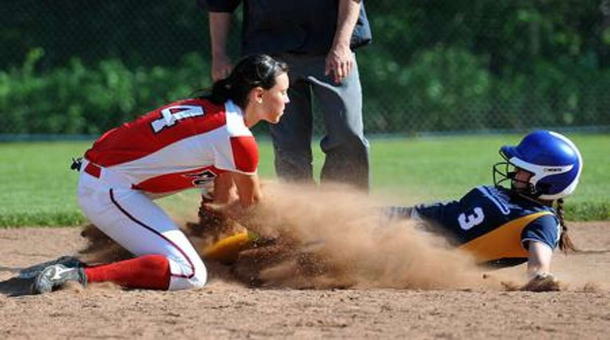 Foran's Brooke Phelan tries to put the tag on Brookfield's Giuliana D'Arcangelo during the second inning. She was safe on the play. Photo-Peter Casolino/New Haven Register