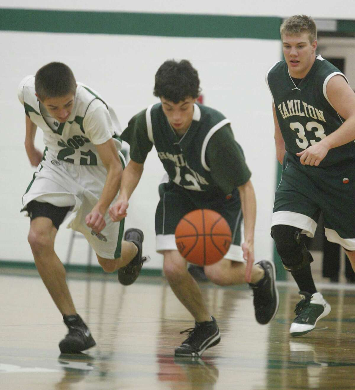 Dispatch Staff Photo by JOHN HAEGER twitter.com/oneidaphoto Hamilton's Zach Dow (33) watches as teammate Allen Schult (12) and Westmoreland's Tyler Witter (25) battle for the ball in their game in Westmoreland on Thursday, Dec. 22 , 2011.