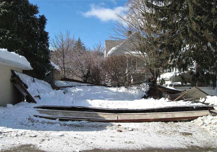 This is all that remains of a three-car garage that collapsed Wednesday night in Ansonia. Patricia Villers/Register