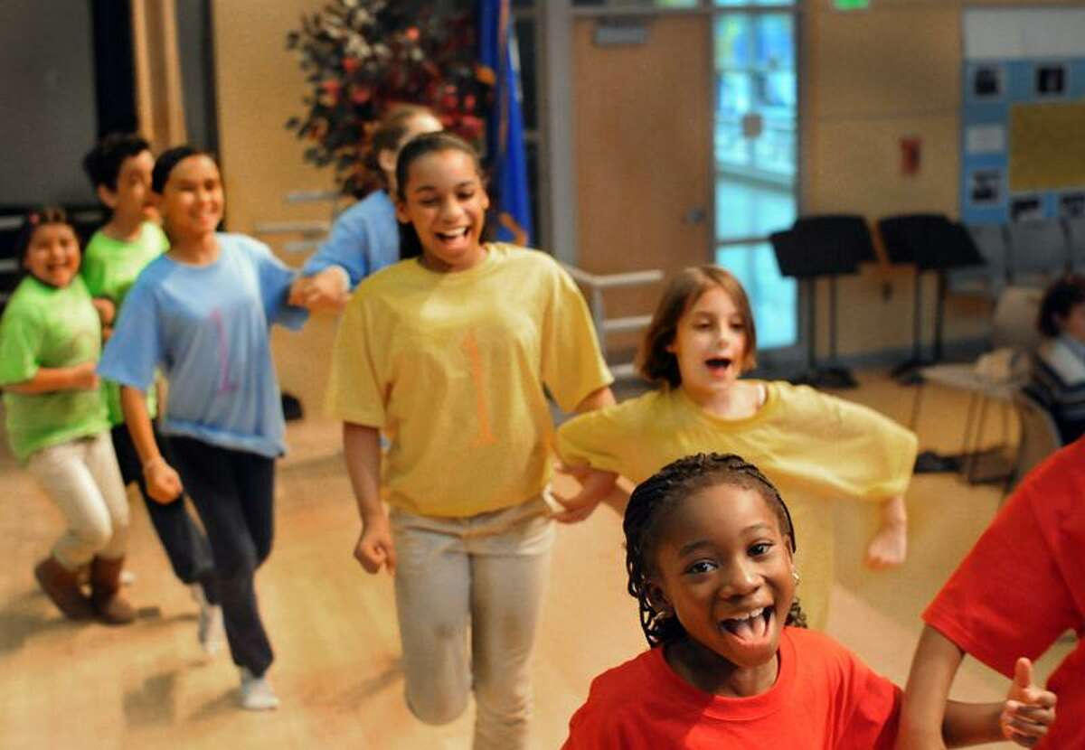 """Melanie Stengel/Register: The Munchkins from John C. Daniels School rehearse for their upcoming appearance in """"The Wizard of Oz"""" at the Shubert Theater."""