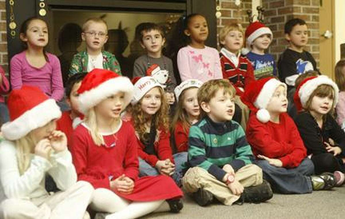 Dispatch Staff Photo by JOHN HAEGER (Twitter.com/OneidaPhoto)E.A. McAllister kindergartners sing Christmas carols for residents at Noyes Manor in Sherrill on Thursday, Dec. 22, 2011.