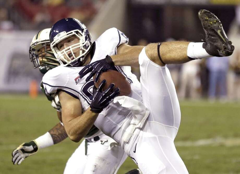 Connecticut tight end Ryan Griffin (94) makes a diving catch on a second quarter pass from quarterback Chandler Whitmer against South Florida during an NCAA college football game on Saturday, Nov. 3, 2012, in Tampa, Fla. (AP Photo/Chris O'Meara) Photo: AP / AP2012