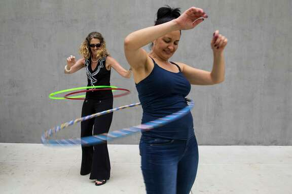 Employees Nancy Nosko, left, and Tonya von Stenzsch try out the latest Hula Hoops at Wham-O's headquarters in the Los Angeles suburb of Carson. The toy, introduced in 1957, sold 100 million units within three years.