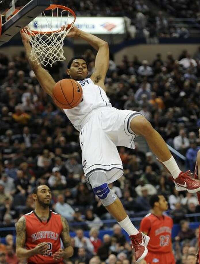 Connecticut's Jeremy Lamb, hangs on the rim after a dunk in the second half of an NCAA college basketball game against Fairfield in Hartford, Conn., Thursday, Dec. 22, 2011. Connecticut won 79-71. (AP Photo/Jessica Hill) Photo: AP / AP2011