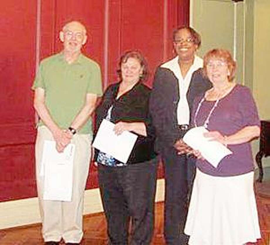 SUBMITTED PHOTO From left: RSVP volunteer Charlie Grover, IRS Relationship Manager Shelley Willette, IRS Territory Manager Dietra Grant, and RSVP Tax Counseling CoordinatorJudy Parker.